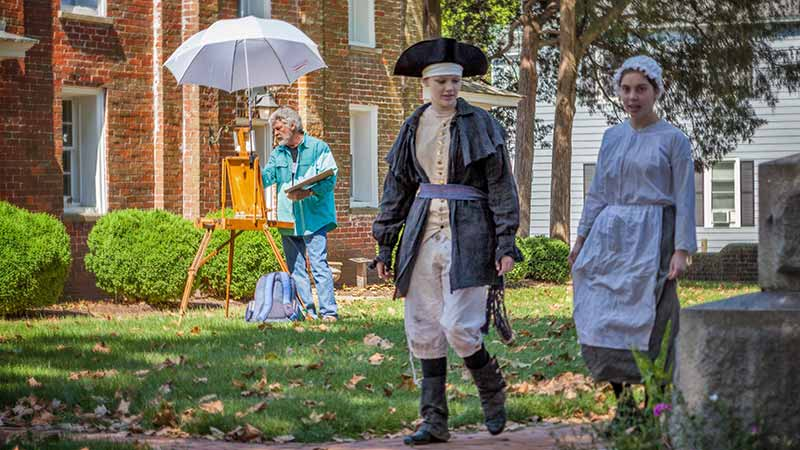 Colonial reenactors and artist at work
