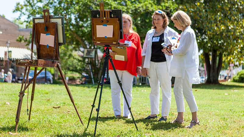 Viewing paintings at Gloucester Arts Festival